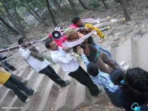 Devotees carrying huge trishul as offering